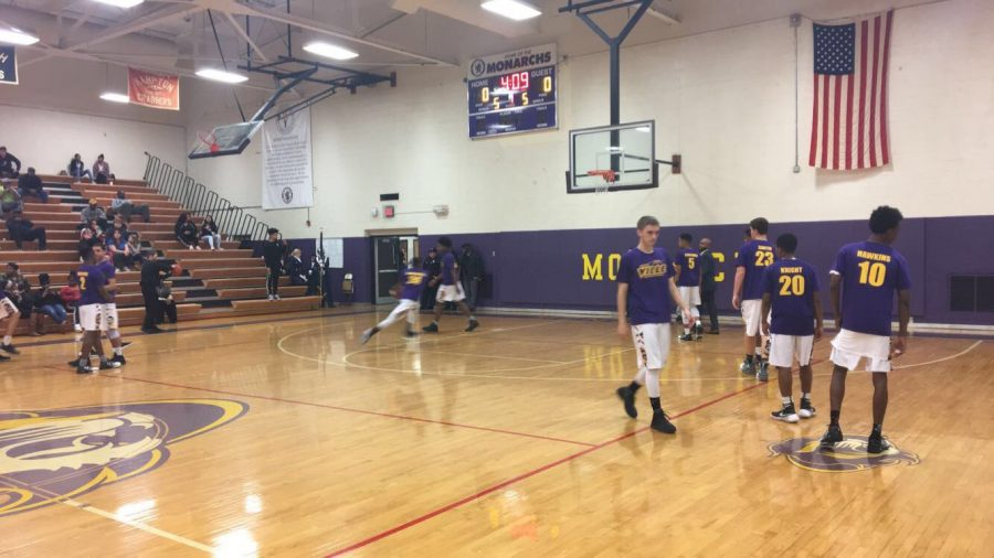 Boys Varsity Basketball team getting warmed up to beat those Raiders