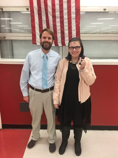 Coach Arram Dreyer with Emma Janney after she placed 2nd in the Conference 10 Forensics Competition.