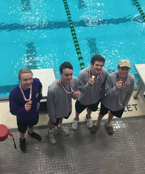 Alex Moore, Miles McAllister, Kade Younger and Brandon Brnich, 1st place medalists in the 200 free relay.