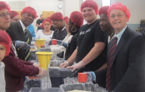 Principal Bobby Surry and Vice Principal Joseph Edwards help students package food