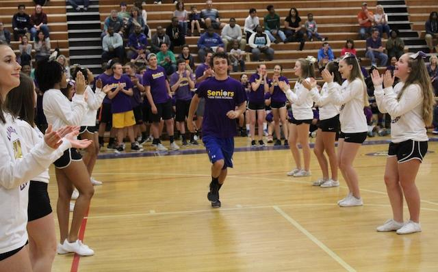 Brandon Mueller sprinting down the court for the starting lineup.