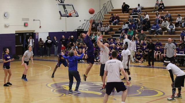 Noah+Webster+and+Brandon+Traner+start+off+the+2017+Senior+Faculty+Basketball+game.+