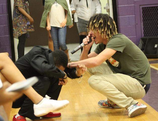Elijah Curry and Coach Dante' Knight dancing and getting down during the halftime performance.