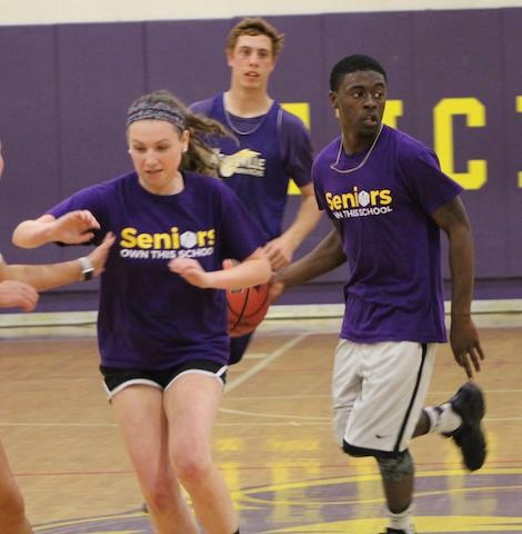 Seniors Lesley Collins, Shemar Butts, and Noah Webster looking for a plan to score on the faculty.