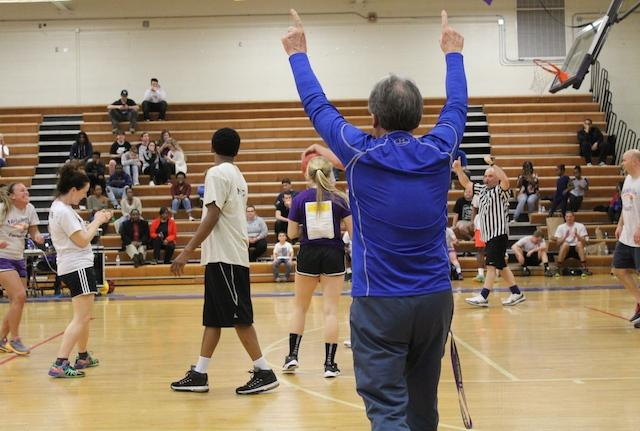 Coach Phil Forbes calls the shots.  Coach Forbes came out of the stands to referee the game when the contracted referees didn't show up.