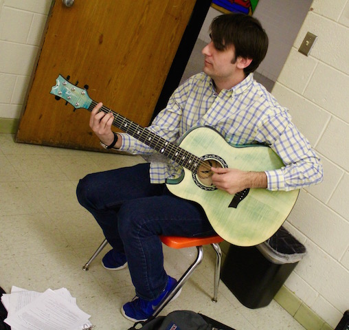 Senior Aaron Hanny practicing in Menchvilles' Beginning Guitar Class.