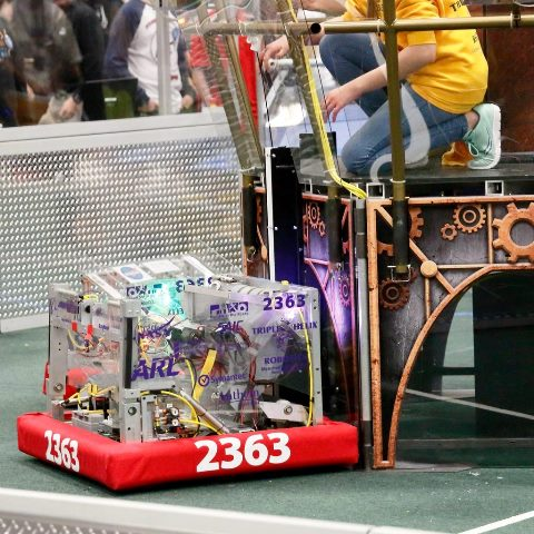 Triple Helix's robot delivers another gear for points in the competition.
