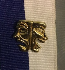 International Thespian Society Inductees received a pin showing the ITS logo.