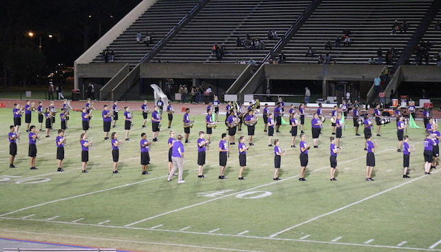 The Marching Monarchs start their show in the classic Superman