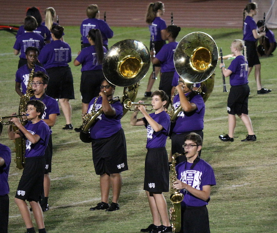 Trumpets, saxophones, and low brass instruments reform during Mars.