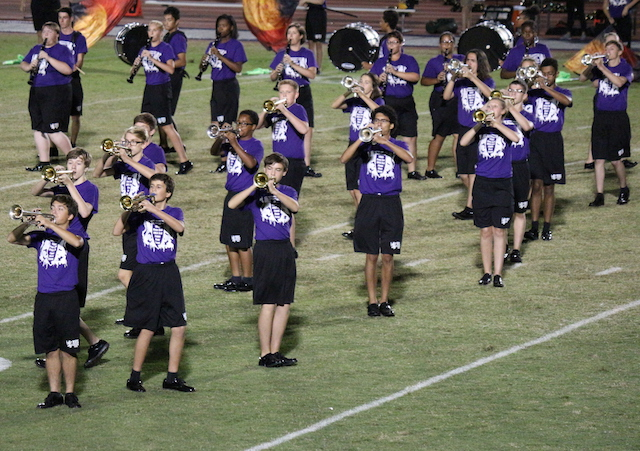Trumpets take the field during the bands performance of Mars by Holst.