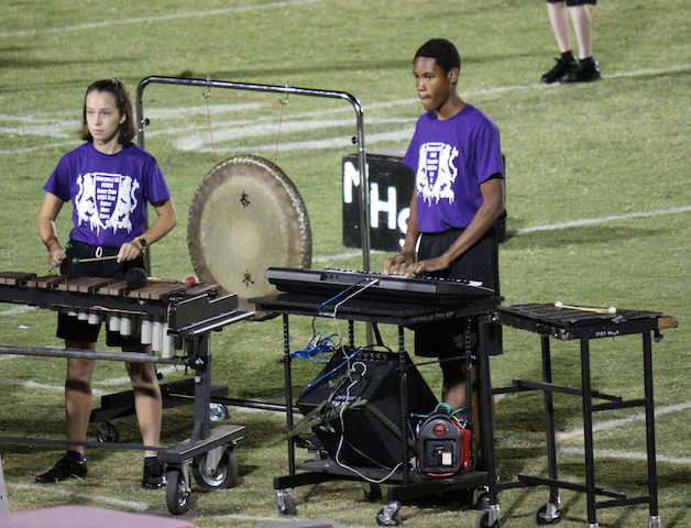 Band members in the pit add to the bands sound with vibraphones and keyboard.