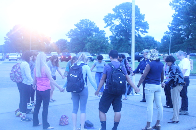 Students%2C+Teachers%2C+and+Faculty+join+hands+in+prayer+at+the+%22Prayer+at+the+Pole%22+event.