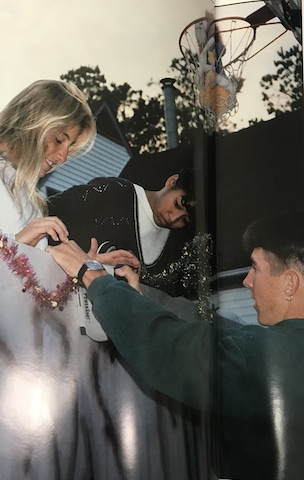 Circa 1995, Suzanne, Lisa Black, and Craig Baxter adding the finishing touches to their float.