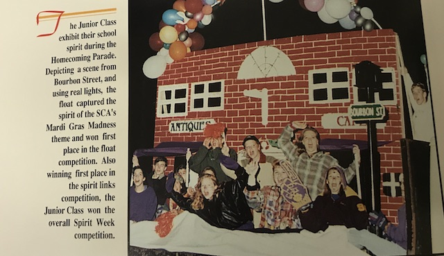 Circa 1995, the Junior class exhibiting their school spirit as they decorate their float - as a scene from Bourbon Street for their Homecoming Parade.