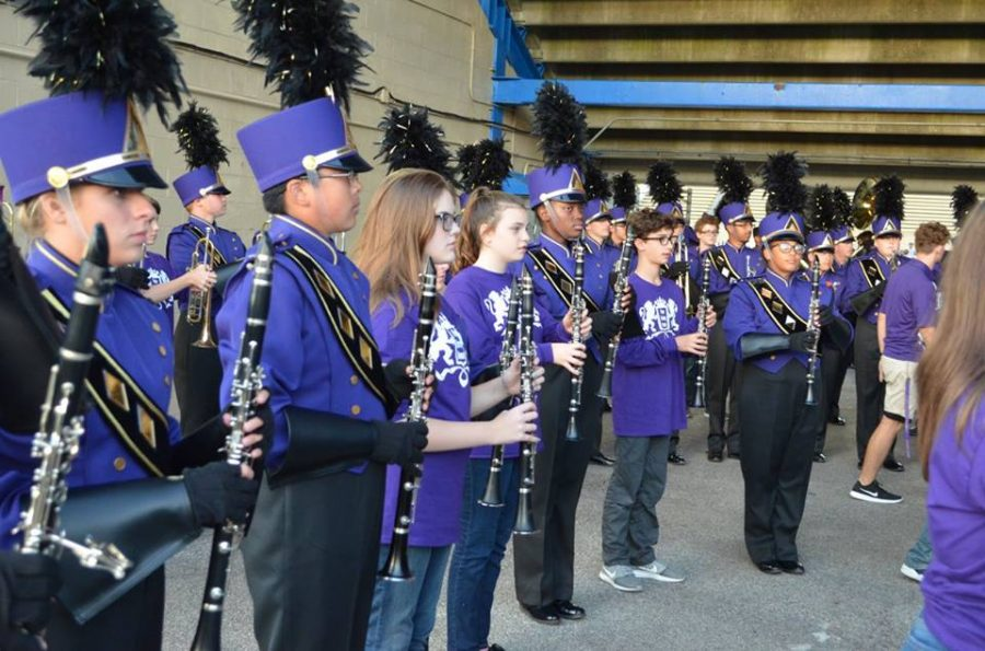 2017- The clarinet section stands at attention before taking the field for the national anthem.