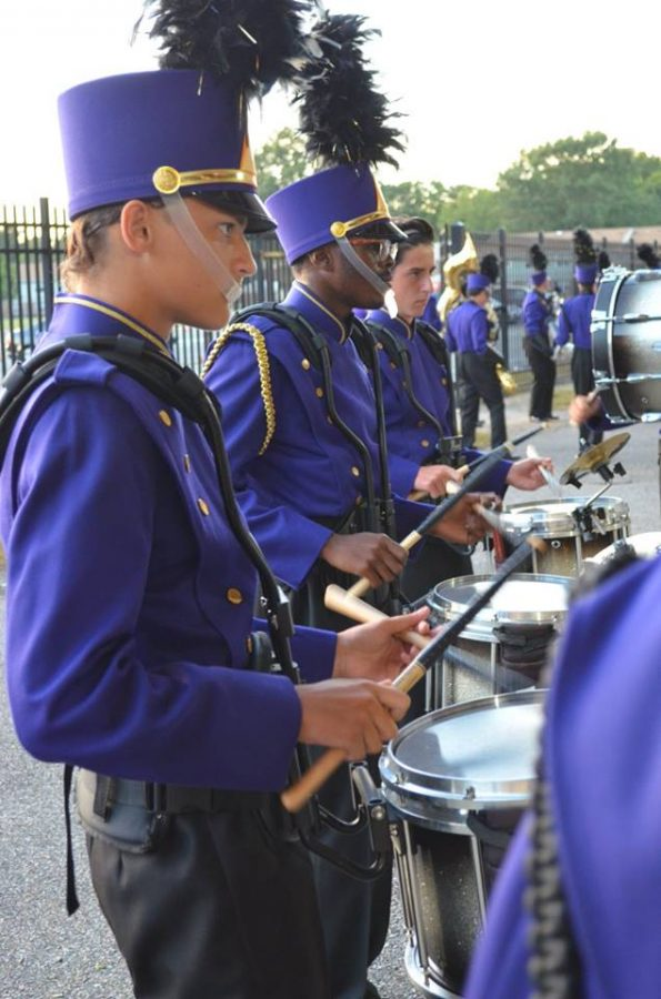 2017- The drumline warms up before the band performance.