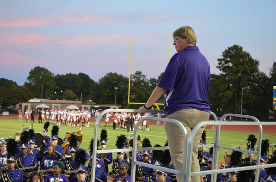 2017- Band Director Deborah Sarvay leads the band in playing the national anthem before a home football game.