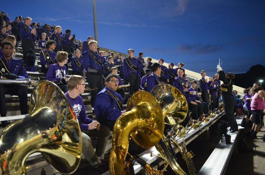 2017- Drum Major Alex Kropp conducts the band from the stands during a football game.