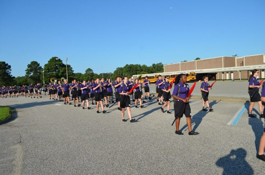 2017- The Marching Monarchs take laps around the Menchville parking lot in preparation for the Denbigh Days Parade.