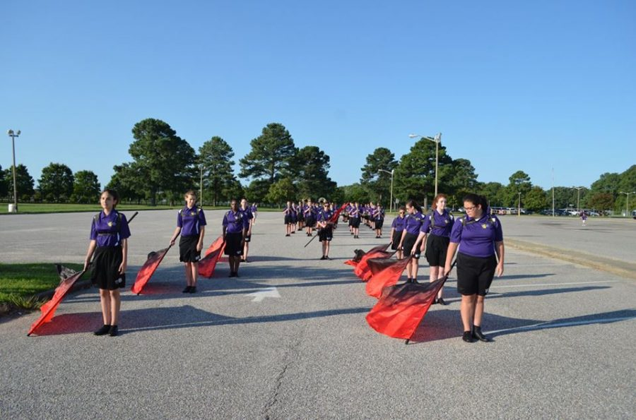 2017- The Menchville Marching Band gathers in the school parking lot to prepare for a parade.