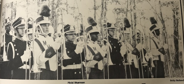 Circa 1992, Marching band is an enjoyable experience because you learn to work well with others and to get things done under pressure. The reward comes with the reaction of the crowd. -Amy Harmaturk