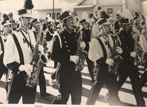 Circa 1992, Combined bands of Menchville and Denbigh march in the Patrick Henry Santa Parade as they play a Christmas song.