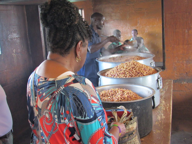 Teachers prepare a large meal for the students.