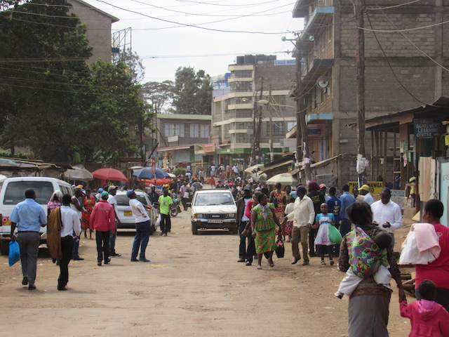 People walk through the busy Kenyan streets.