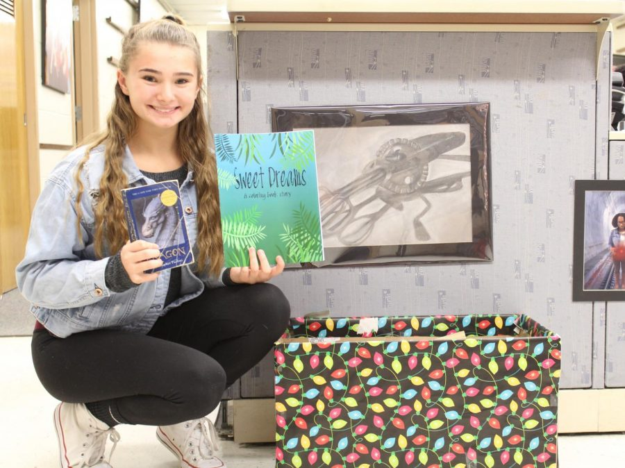 Student Ambassador President Kayla Egnot is grateful for all the books that have been donated so far.  The book drive runs through December 19.
