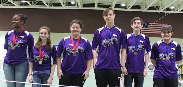 Menchville had a clean sweep at the City Archery Tournament with first through third finishes in both the girls and boys divisions. (From the right) Alan McGuire placed first, Felix Arsenault second, and Chris Kessel third. (From the left) Courtney Hodge placed first and highest score overall, Sherry Paranuk placed second, and Hannah Hollis placed third.