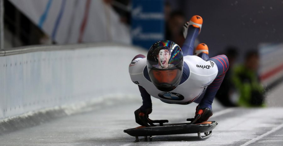 Skeleton racers take off along an ice track, positioning themselves on sleds head-first.