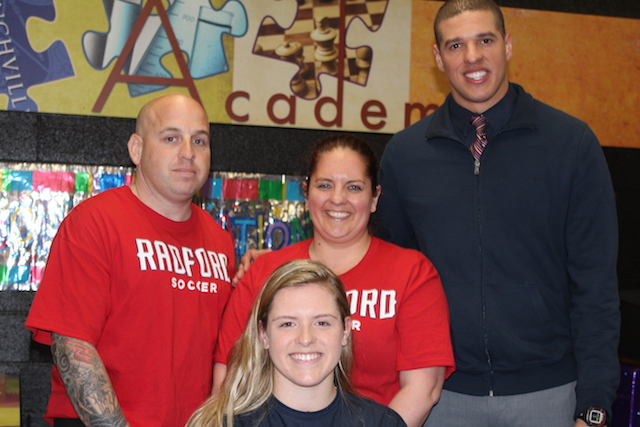 Kaitlyn Casab, her parents, and Coach Dennis Zolicoffer