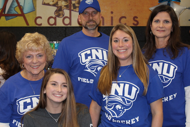 Sarah Coon (front), Coach Nicole Kuykendall (right),  her grandmother (back row), and her parents (back row)