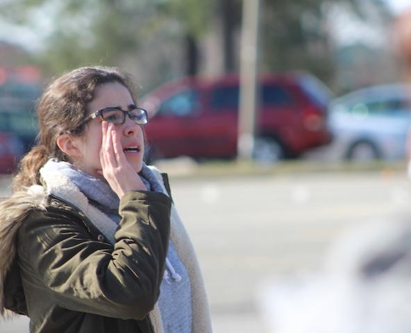 Senior Sophia Ramirez calls for attention at the protest.