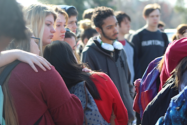Students console one another during the silence for reflection.