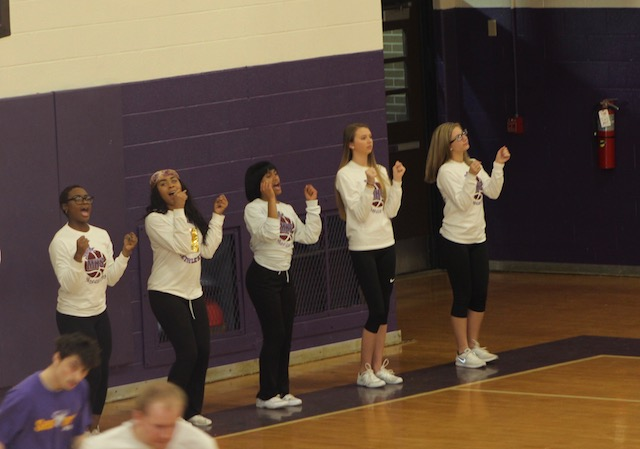 Menchvilles cheerleaders support players from the side of the court.