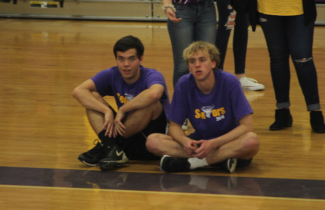 Seniors sit courtside, watching their peers face off against their teachers.