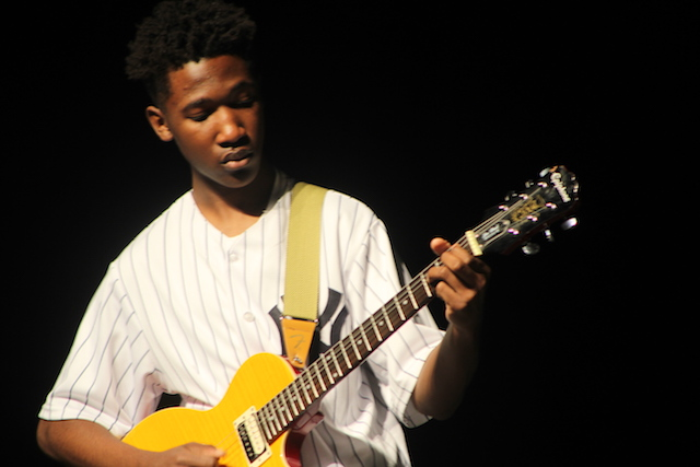 Andre Smith rocks out on his guitar.