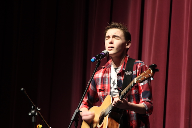 Evan Gray sings beautifully and plays along on the. guitar.