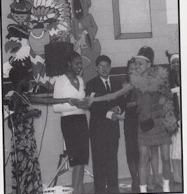Senior class of 97,  Patrice McCoy at Senior Breakfast presenting the Best Actress award to Kisha Nichols.