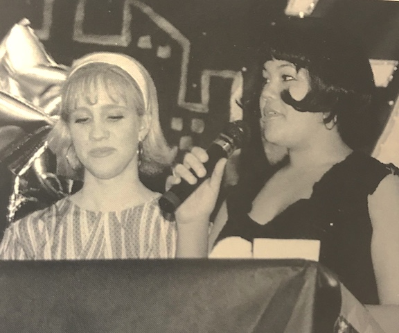 Seniors of 2002, Christina Hammond and Marie Martinez announcing the winners for Most Original. Martinez borrowed her costume from her parents, while Hammond shopped for her costume.