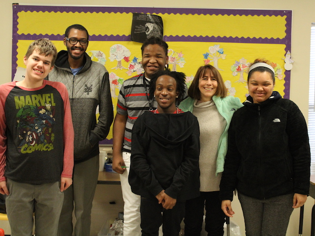 Swanenburg and some of her students posed for a picture in front of their food prep station.
