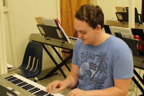 Nicolas Gonzalez practices the keyboard during lunch.