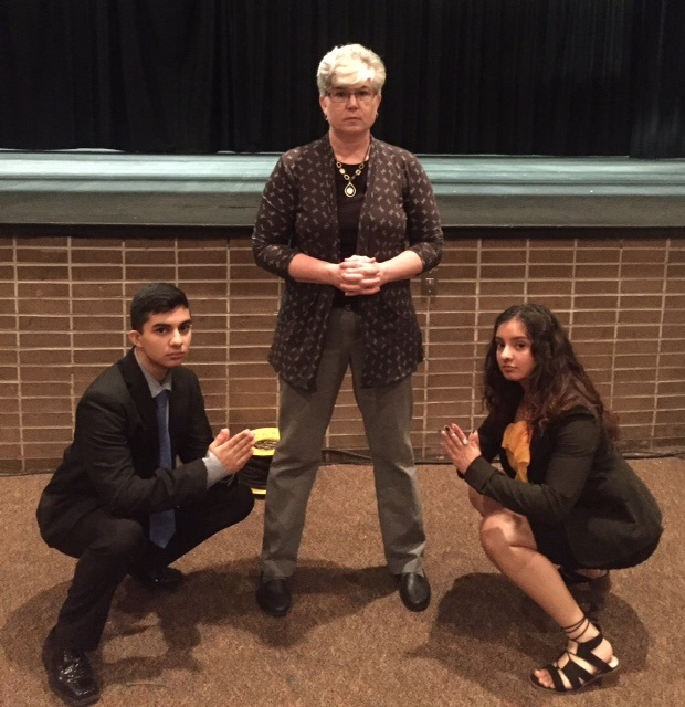 Karan Singh, Ashley Chassard and Devin Singh pose at the end of the presentation.