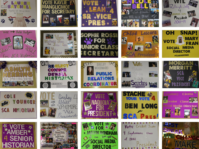 Campaign posters are displayed along the Menchville hallway by the office.