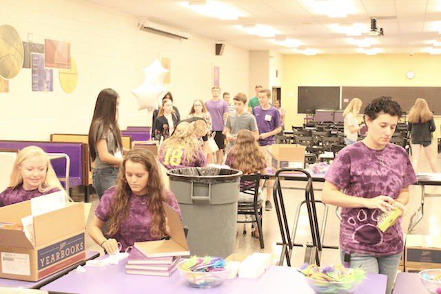 Yearbook staff ready to hand out yearbooks to the oncoming droves of students.