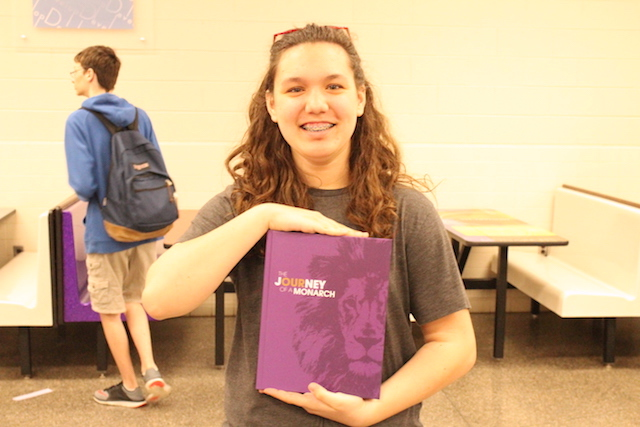 Freshman Shelby Woodward holds her new 2017-2018 yearbook.
