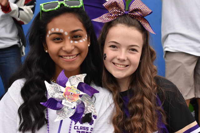 Freshman Alister Sanchez-Lapitan and Ragan Maynard pose on their Minecraft themed float for Menchville's annual Homecoming Parade.