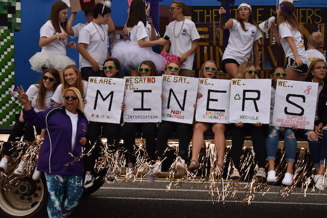 The Freshman and Ms. Rodriguez pose for a photo on their Minecraft themed float at Menchville's annual Homecoming Parade.